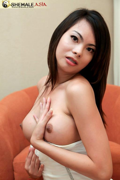Asian Ladyboy In Pink Posing