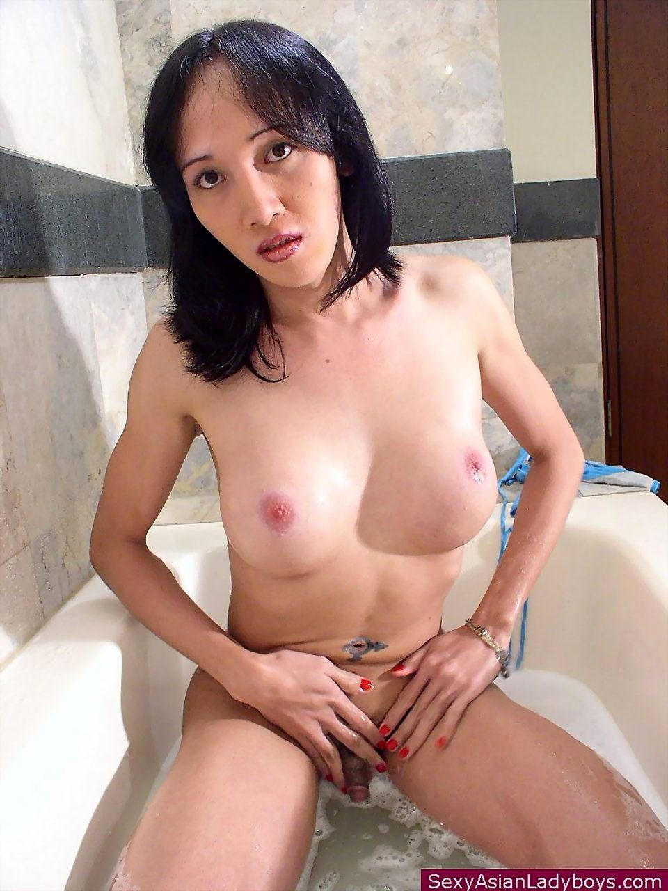 Cute Asian Shemale Pinky Playing With Her Anal Beads