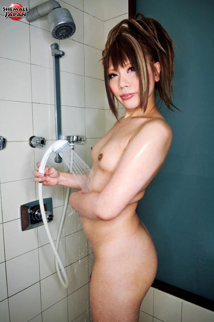 Pretty Transexual Chick In Red Stroking Her Huge Penis